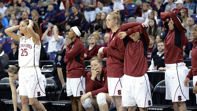 Stanford players react to their loss to Georgia in the second half of a regional semifinal in the NCAA women's college basketball tournament, Saturday March 30, 2013 in Spokane, Wash. Georgia won 61-59. (AP Photo/Jed Conklin)