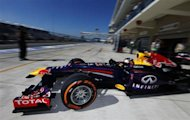 Red Bull Formula One driver Sebastian Vettel of Germany drives out of his garage during the second practice session of the Austin F1 Grand Prix at the Circuit of the Americas in Austin November 15, 2013. REUTERS/Adrees Latif