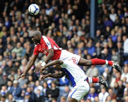 Arsenal's Campbell challenges Blackburn Rovers' Roberts during their English Premier League soccer match in Blackburn