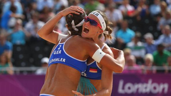 Katrin Holtwick (R) and Ilka Semmler of Germany celebrate during the Women's Beach Volleyball match between Germany and Czech Republic on Day 1 of the London 2012 Olympic Games at Horse Guards Parade on July 28, 2012 in London, England. (Photo by Alexander Hassenstein/Getty Images)