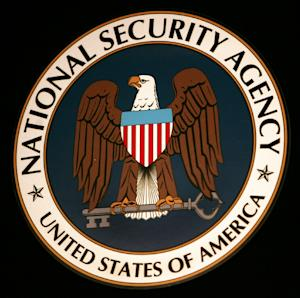 The logo of the National Security Agency hangs at the Threat Operations Center inside the NSA in the Washington suburb of Fort Meade, Maryland, January 25, 2006