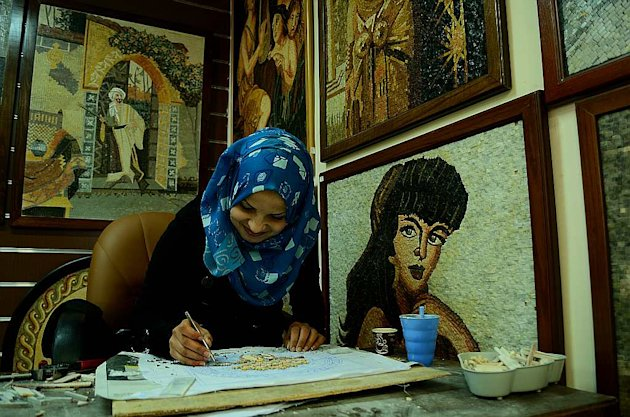 An artisan works on a Madaba mosaic replica.