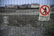 A sign warns people not to enter the prohibited area of a building site, next to Pamplona, northern Spain, Friday, Jan. 27, 2012. The National Statistics Institute says Spain's unemployment figures has surpassed the 5 million mark, with the jobless rate rising to 22.8 percent in the fourth quarter of 2011, and prompting the new conservative Popular Party government to pledge new labor reforms. (AP Photo/Alvaro Barrientos)