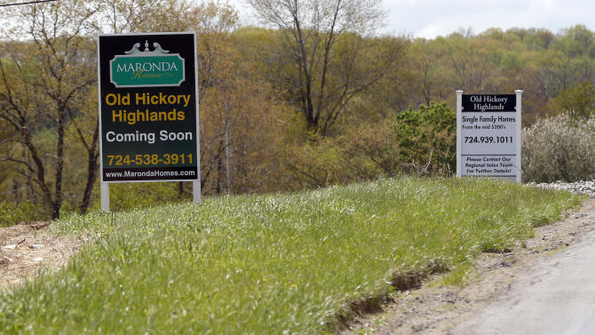 In this Monday, May 6, 2013 photo, construction is underway on the infrastructure of a multi-acre housing development in Zelienople, Pa. The Commerce Department reports on new-home sales for May, on Tuesday, June 25, 2013. (AP Photo/Keith Srakocic)