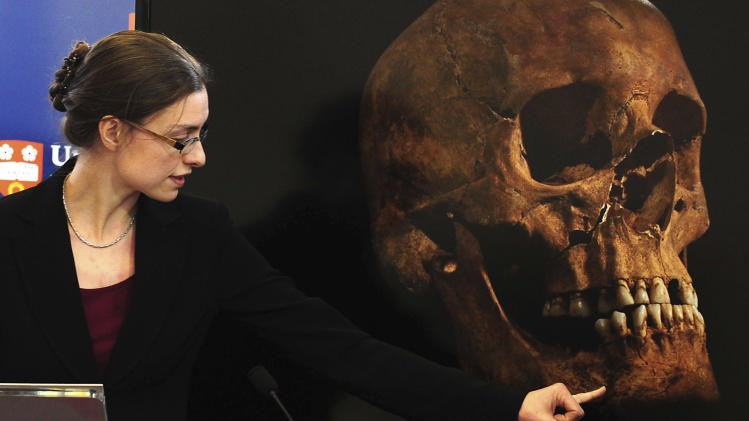 Jo Appleby, a lecturer in Human Bioarchaeology, at University of Leicester, School of Archaeology and Ancient History, who led the exhumation of the remains found during a dig at a Leicester car park, speaks at the university Monday Feb. 4, 2013. Tests have established that a skeleton found , including this skull, are