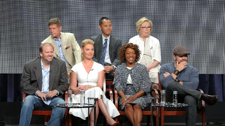 "This image released by NBC shows, back row from left, executive producers Bob Simonds, Rodney Faraon, Nancy Heigl, and front row from left, executive producers Ed Bernero, Katherine Heigl, actress Alfre Woodard and executive producer Joe Carnahan at the ""State of Affairs"" panel at the NBC 2014 Summer TCA on Sunday, July 13, 2014, in Beverly Hills, Calif. (AP Photo/NBC, Chris Haston)"