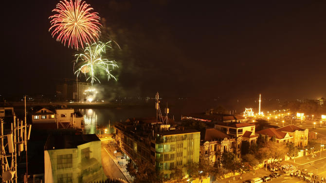 "Fireworks explode over the Tonle Sap River for the cremation of Cambodia's former King Norodom Sihanouk in Phnom Penh, Cambodia, Monday, Feb. 4, 2013. Hundreds of thousands of mourners gathered in Cambodia's capital Monday for the cremation of Sihanouk, the revered ""King-Father,"" who survived wars and the murderous Khmer Rouge regime to hold center stage in the Southeast Asian nation for more than half a century. (AP Photo/Heng Sinith)"