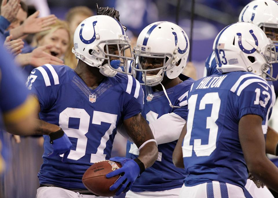 Indianapolis Colts wide receiver Reggie Wayne, left, celebrates with Colts wide receiver Donnie Avery after scoring a touchdown against the Miami Dolphins during the first half of an NFL football game in Indianapolis, Sunday, Nov. 4, 2012. (AP Photo/AJ Mast)