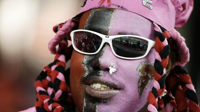 Charles Motin, of Atlanta, wearing Breast Cancer Awareness makeup, watches players warm up before the first half of an NFL football game between the Atlanta Falcons and the New York Jets, Monday, Oct. 7, 2013, in Atlanta