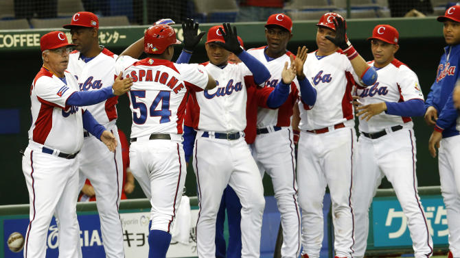 Cuba's leftfielder Alfredo Despaigne (54) celebrates with teammates after hitting solo- homer off Netherlands' pitcher Diegomar Markwell in the second inning of their World Baseball Classic second round game in Tokyo, Japan, Friday, March 8, 2013. (AP Photo/Koji Sasahara)