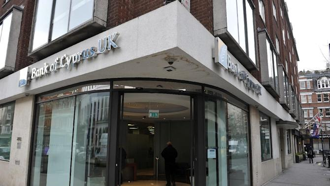 A view of the Bank of Cyprus UK in Charlotte Street, central London, Monday, March 18, 2013.  The euro 10 billion (US dlrs13 billion) Cyprus bailout agreed by the EU and IMF demands that all bank customers pay a one-off levy on all bank deposits, to save the country from bankruptcy.  Cyprus' president Nicos Anastasiades urged lawmakers to approve the tax when they vote Monday, saying he wants to amend the unpopular eurozone bailout plan to reduce its effect on small savers.  (AP Photo / Nick Ansell, PA) UNITED KINGDOM OUT - NO SALES - NO ARCHIVES