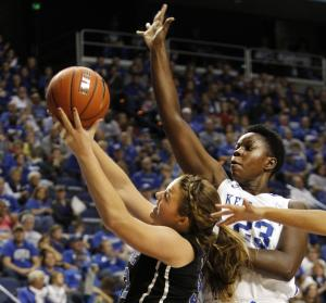 Duke's Tricia Liston, left, shoots under pressure from Kentucky's Samarie Walker during the second half of an NCAA college basketball game, Sunday, Dec. 22, 2013, in Lexington, Ky. Liston led all players with 28 points in Duke's 69-61 win. (AP Photo/James Crisp)