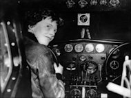 Undated picture taken in the 1930's of American aviator Amelia Earhart at the controls of her plane. An expedition to test the theory that aviatrix Earhart survived the crash of her airplane 75 years ago and died a castaway on a desert island has left Hawaii