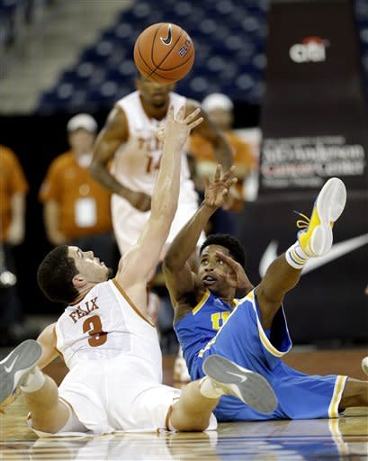 Adams helps UCLA rally past Texas 65-63