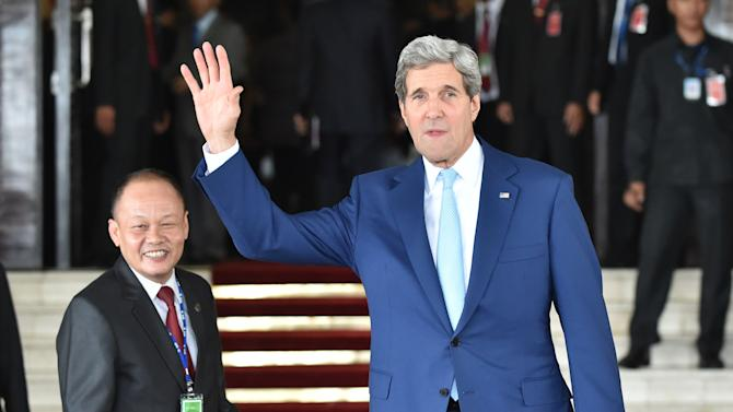 US Secretary of State John Kerry (right) attends the inaugural ceremony of new Indonesian President Joko Widodo in Jakarta, on October 20, 2014