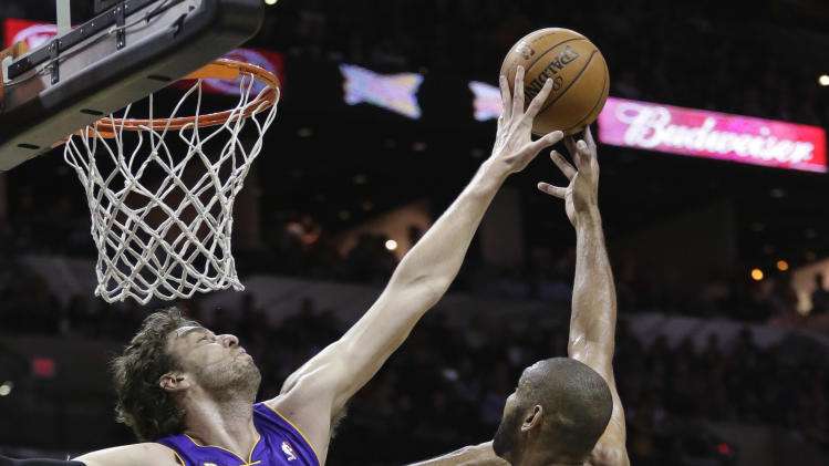 San Antonio Spurs' Tim Duncan (21) is blocked by Los Angeles Lakers' Pau Gasol (16), of Spain, during the first half of Game 2 of a first-round NBA basketball playoff series on Wednesday, April 24, 2013, in San Antonio, Texas. (AP Photo/Eric Gay)