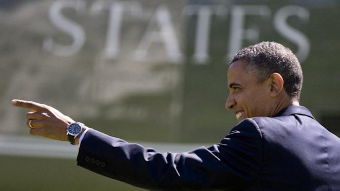 President Barack Obama point to people on the South Lawn of the White House in Washington, Monday, Sept. 24, 2012, as he walks from the Oval Office to Marine One,  Monday, Sept. 24, 2012, en route to New York.  (AP Photo/Carolyn Kaster)
