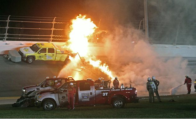 Feb. 27 Emergency workers try to put out a fire after Juan Pablo Montoya's car struck the truck during the NASCAR Daytona 500 auto race at Daytona International Speedway in Daytona Beach, Fla., Mo