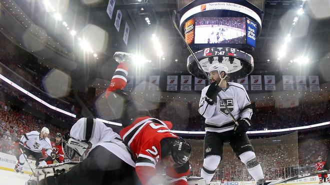 Patrik Elias #26 Of The New Jersey Devils Collides With Jonathan Quick #32 Of The Los Angeles Kings As Drew Doughty # Getty Images