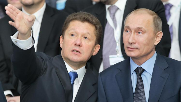 FILE In this Friday, Dec. 7, 2012 file photo Russian President Vladimir Putin, right, and Gazprom CEO Alexei Miller speak during a ceremony in Anapa, Russia. At a lavish ceremony in December to mark the start of construction of a new Russian pipeline, Gazprom put on a show of its industrial might to match the project's euro 16 billion ($20.92 billion) price tag. On the Black Sea coast, 600 miles south of Moscow, the company built a eight massive steel-framed marquees to house Russia's President Vladimir Putin, Gazprom's executives and various European partners all for a two-hour ceremony in which two short sections of the new South Stream pipeline were welded together. (AP Photo/Mikhail Metze, File)