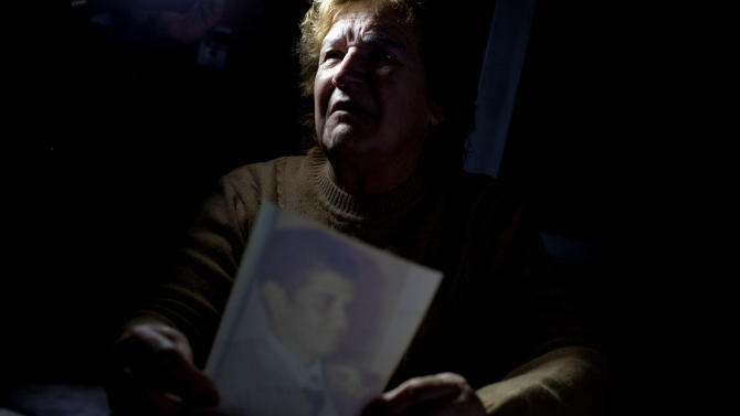 "In this May 31, 2012 photo, Nelida Montoya, mother of Horacio Echave, a soldier who died during the Falklands war between Argentina and Great Britain, holds a picture of her son at her home in Lobos, Argentina. Horacio Echave was only 19 when he died on June 14, 1982, the day Argentines surrendered to British forces and ended their 74-day occupation of the archipelago they still claim as their ""Islas Malvinas."" His body is one of 123 that could not be identified and were reburied as ""unknown"" soldiers in the Argentine military cemetery near Darwin, a settlement hours from the capital of Stanley where many soldiers on both sides fell in close combat 30 years ago.  (AP Photo/Natacha Pisarenko)"