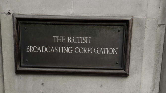 A placard is seen as BBC journalists mount picket lines after launching a 24-hour strike in a row over jobs, outside the BBC Broadcasting House, in central London, Monday, Feb. 18, 2013. (AP Photo/Lefteris Pitarakis)