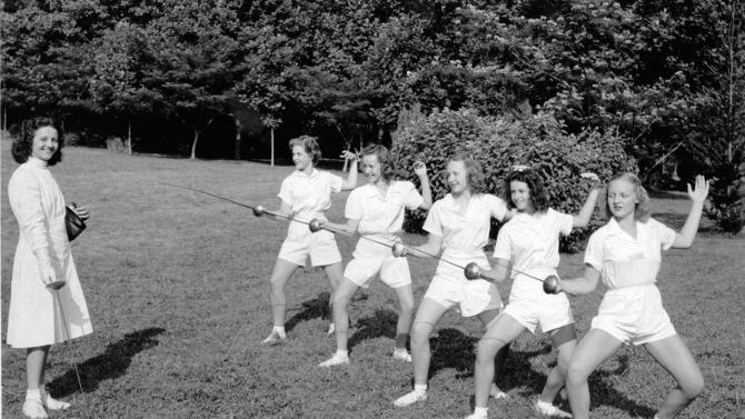 This undated photo released by Camp Greystone shows girls wearing uniforms while fencing at Camp Greystone in Tuxedo, N.C.  Of 361 camps surveyed recently by the American Camp Association, about 71 percent said they have some form of dress code, uniform or restriction on makeup and swimwear. Today's camp uniforms are far from the boxy, itchy garb of yesteryear.   (AP Photo/Camp Greystone)