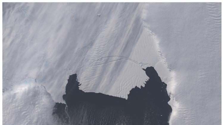 The B-31 Iceberg is seen before and after separating from a rift in Antarctica's Pine Island Glacier