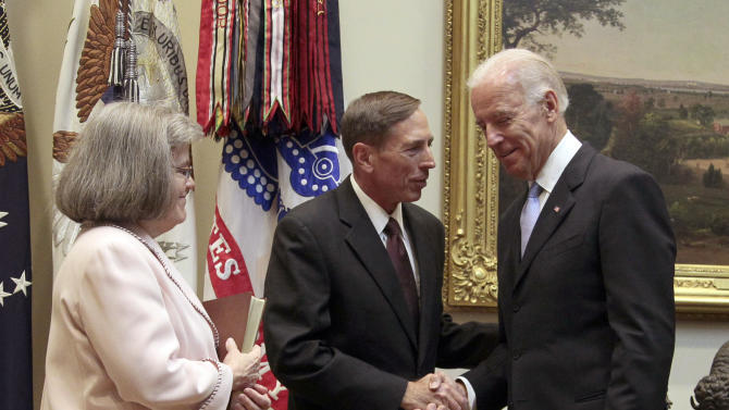 Vice President Joe Biden, right, shakes hands with Dir. of the CIA David Petraeus, center, after administering the oath of office during a swearing-in ceremony in the Roosevelt Room of the White House in Washington, Tuesday, Sept., 6, 2011. On the left is Petraeus' wife Holly Knowlton Petraeus. (AP Photo/Pablo Martinez Monsivais)