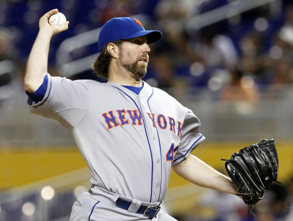 New York Mets' R.A. Dickey pitches against the Miami Marlins in the first inning of a baseball game in Miami, Tuesday, Oct. 2, 2012. (AP Photo/Alan Diaz)
