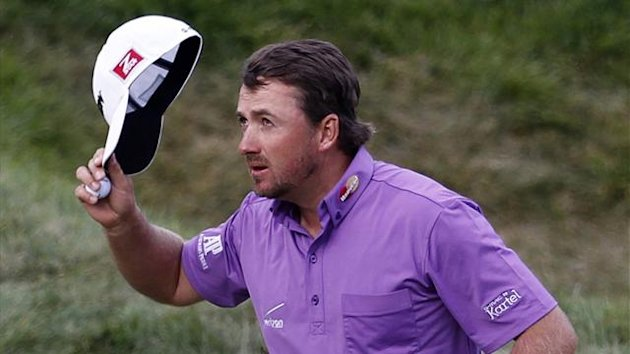 Northern Ireland's Graeme McDowell reacts after his birdie on the 18th green during the third round for the 2012 U.S. Open golf tournament on the Lake Course at the Olympic Club in San Francisco, California