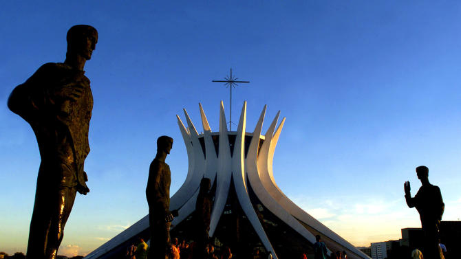 FILE - In this April 21, 2003 file photo, the statues of the apostles are seen in front of the Cathedral of Brasilia, an architectural landmark created by architect Oscar Niemeyer, in Brasilia, Brazil.  According to a hospital spokeswoman on Wednesday, Dec. 5, 2012, famed Brazilian architect Oscar Niemeyer has died at age 104.  (AP Photo/Eraldo Peres, File)
