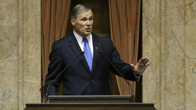 FILE - In this Jan. 16, 2013 file photo, Washington Gov. Jay Inslee speaks to a joint session of the Washington Legislature in Olympia, Wash. Washington state lawmakers are proposing to move some government workers out of a state-sponsored health plan and into an exchange developed under President Barack Obama's health care law. (AP Photo/Ted S. Warren, file)