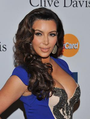 FILE -- In a Feb. 11, 2012 file photo Kim Kardashian arrives at the Pre-GRAMMY Gala & Salute to Industry Icons  in Beverly Hills, Calif.  Sheriff's deputies say a woman threw powder on Kim Kardashian in the lobby of a West Hollywood, Calif., hotel Thursday March 22, 2012.(AP Photo/Vince Bucci/file)