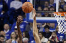 Texas-Arlington's Johnny Hill (10) has his shot blocked by Kentucky's Karl-Anthony Towns during the first half of an NCAA college basketball game, Tuesday, Nov. 25, 2014, in Lexington, Ky. (AP Photo/James Crisp)