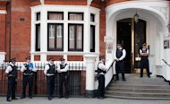 &lt;p&gt;Police officers stand outside the Ecuadorian Embassy in London on August 17. Despite Ecuador providing a haven for Assange, British Foreign Secretary William Hague said Britain was obliged under its own laws to extradite him to Sweden.&lt;/p&gt;