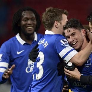 Everton players celebrate defeating Manchester United during their English Premier League soccer match at Old Trafford in Manchester