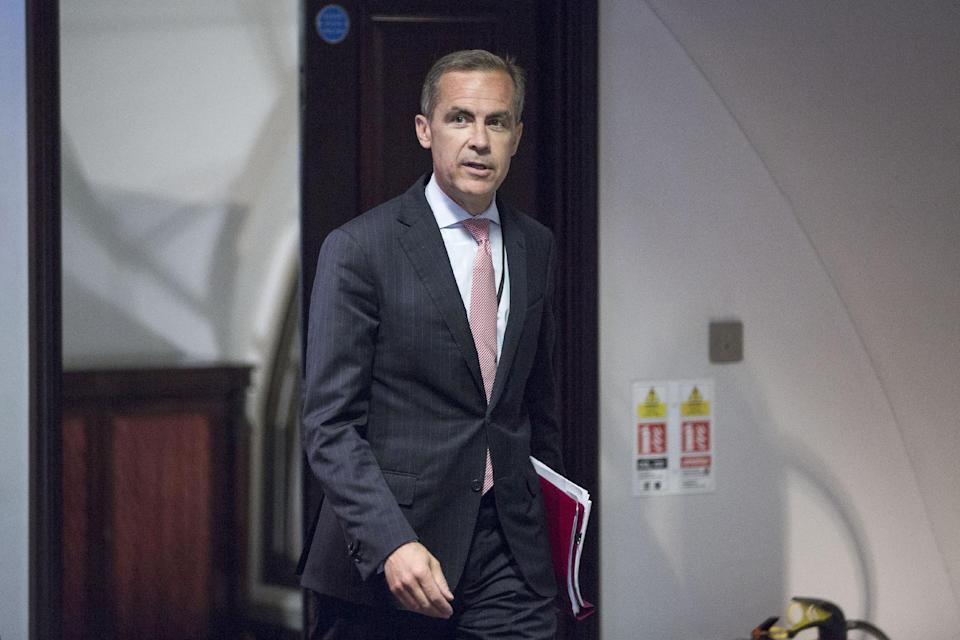 Mark Carney, the new Governor of the Bank of England, arrives for a monetary policy committee (MPC) briefing on his first day on the job inside the central bank's headquarters in London Monday July 1, 2013. (AP Photo/Jason Alden/Pool)