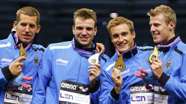 Team Germany's Lebherz, Biedermann, Backhaus and Rapp pose with medals after winning the men's 4x200m freestyle final at the European Swimming Championships in Berlin