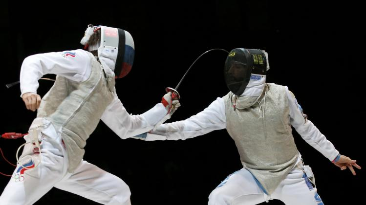 Rigin of Russia competes against Avola of Italy in the men's team foil third place match at the World Fencing Championships in Kazan