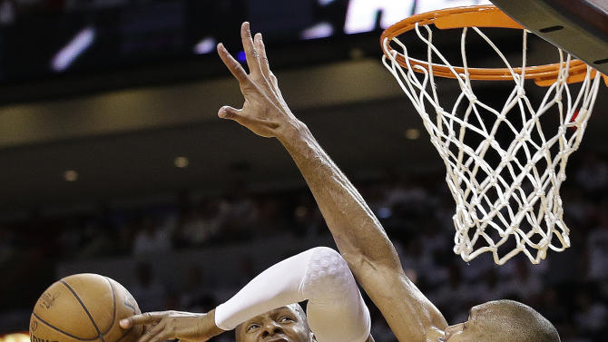 Miami Heat shooting guard Ray Allen (34) is fouled by San Antonio Spurs power forward Tim Duncan (21) during the second half of Game 1 of the NBA Finals basketball game, Thursday, June 6, 2013 in Miami. (AP Photo/Lynne Sladky)