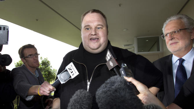 FILE - In this Feb. 22, 2012 file photo, Kim Dotcom, the founder of the file-sharing website Megaupload, comments after he was granted bail and released in Auckland, New Zealand. In the eyes of New Zealand immigration authorities in 2010, Kim Dotcom's money trumped his criminal past. Documents released to The Associated Press this week under New Zealand public records laws show that immigration officials granted the Megaupload founder residency that year after deciding the money he could bring to the country outweighed concern about criminal convictions in his native Germany for computer fraud and stock-price manipulation. (AP Photo/New Zealand Herald, Brett Phibbs, File) NEW ZEALAND OUT, AUSTRALIA OUT