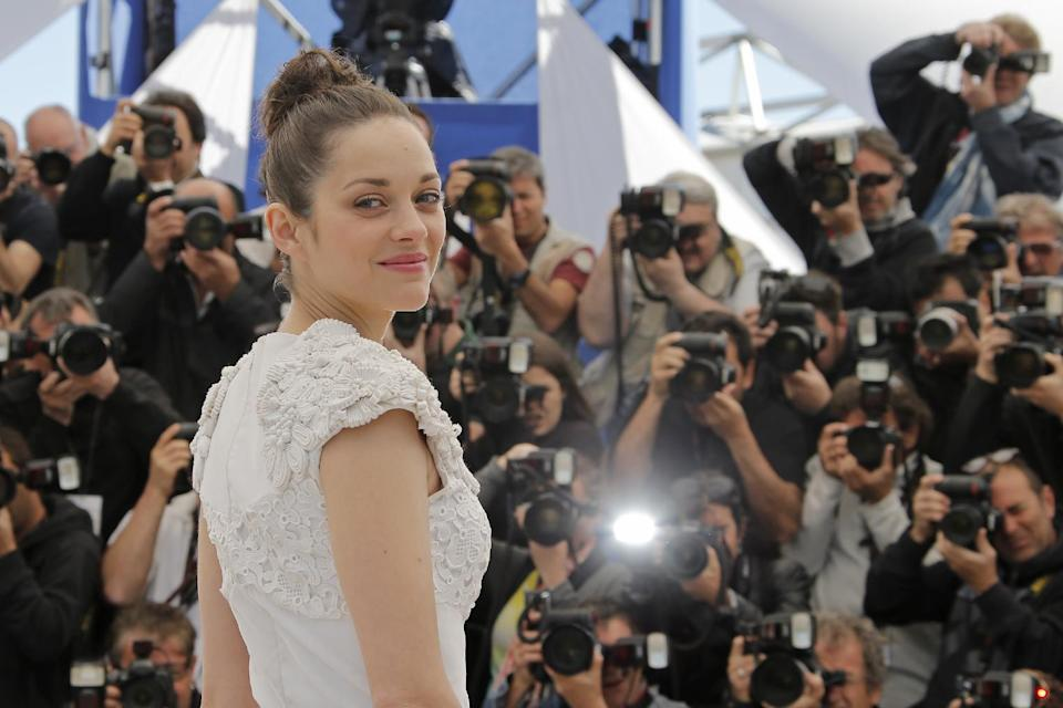 Actress Marion Cotillard poses for photographers during a photo call for the film The Immigrant at the 66th international film festival, in Cannes, southern France, Friday, May 24, 2013. (AP Photo/Francois Mori)