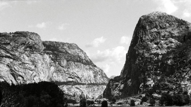 FILE - This pre-1913 file photo shows the Hetch Hetchy Valley in Yosemite National Park, Calif. This fall San Franciscans will vote on a local measure with national implications: it could return to the American people a flooded gorge described as the twin of breathtaking Yosemite Valley. Voters will decide whether to drain a 117-billion-gallon Hetch Hetchy reservoir in Yosemite National Park, exposing for the first time in 80 years a glacially carved, granite-ringed valley of towering waterfalls 17 miles north of its more famous sibling. (AP Photo/Bancroft Library via Environmental Defense, File)