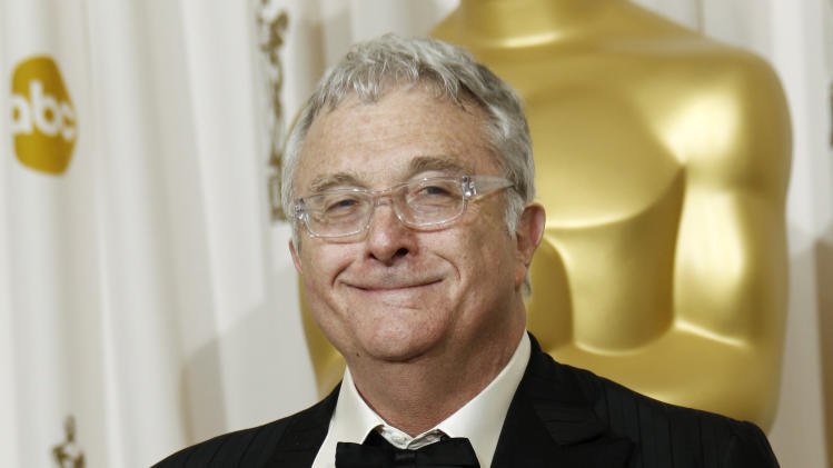 "FILE - This Feb. 27, 2011 file photo shows composer Randy Newman posing backstage with the Oscar for best original song  for ""We Belong Together"" from ""Toy Story 3"" at the 83rd Academy Awards in the Hollywood section of Los Angeles. Newman is weighing in on the presidential election, and he's playing the race card through a song he wrote. I'm Dreaming"" is full of satirical, sarcastic _ and signature Newman _ anecdotes about someone who votes for the president because he is white. It features the refrain: ""I'm dreaming of a white president."" Newman is openly supporting President Barack Obama. He says though the song is serious, he wants the public to find comedic relief in it.(AP Photo/Matt Sayles, File)"