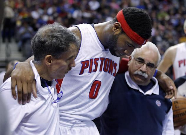 Detroit Pistons center Andre Drummond (0) is helped off the court by strength coach Arnie Kander, left, and athletic trainer Mike Abdenour after being hit in the head during the first half of an NBA b