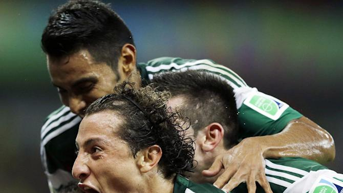 FILE - In this June 23, 2014 file photo, Mexico's Andres Guardado celebrates with teammates after Rafael Marquez scored the team's first goal during their World Cup soccer match with Croatia in Recife, Brazil. (AP Photo/Ricardo Mazalan, File)
