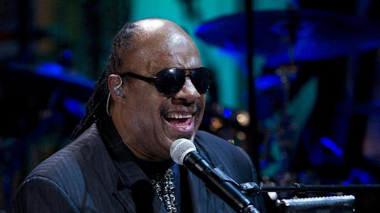 "FILE - In a Wednesday, May 9, 2012 file photo, Stevie Wonder performs during the ""In Performance at the White House"" in the East Room of the White House in Washington, honoring songwriters Burt Bacharach and Hal David, recipients of the 2012 Library of Congress Gershwin Prize for Popular Song. Kelly Clarkson and fun. are just two of the acts who will perform during the upcoming inaugural festivities, which also includes Beyonce, James Taylor, Stevie Wonder, Katy Perry and dozens of others.  (AP Photo/Carolyn Kaster, File)"