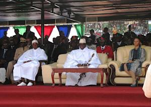 Yayah Jammeh (centre) sits with his wife Zeinab Yahya …