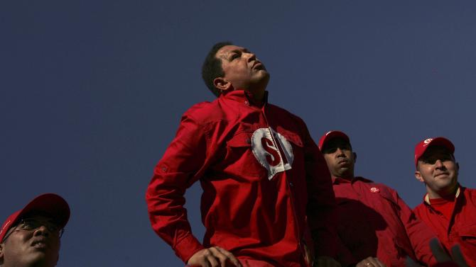 FILE - In this Nov. 30, 2007 file photo, Venezuela's President Hugo Chavez arrives to a rally in support of changes to the nation's constitution in Caracas, Venezuela.  After four election wins, Chavez is on track to completing at least 20 years in power. (AP Photo/Rodrigo Abd, File)